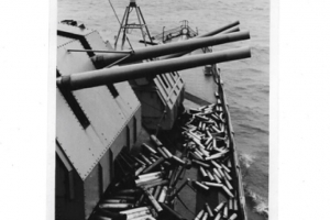 Expended shell casings litter the deck