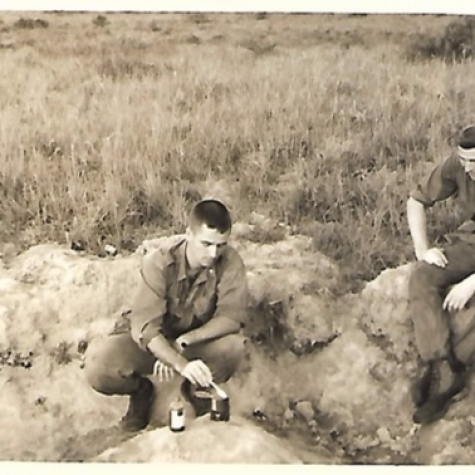 Platoon Sgt and Lt Andrews heat C-Rations 1967