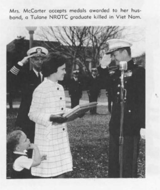Mrs McCarter accepts medals awarded to her husband Captain James McCarter,(1962), who was killed in Viet Nam